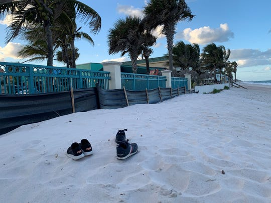 A pair of sneakers are seen in the dune Sunday, Feb. 9, 2020,  at Vero Beach's Sexton Plaza.