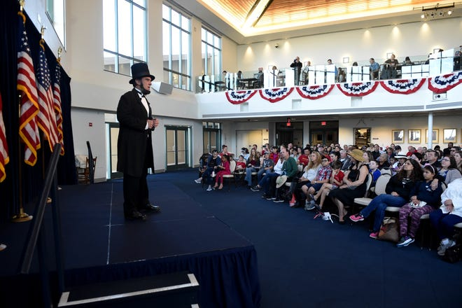 An actor portrays Abraham Lincoln during a Presidents Day celebration at the Ronald Reagan Presidential Library & Museum, in Simi Valley, California. Donald Trump reportedly hopes to raise $2 billion for his library, and possibly build it in Florida.