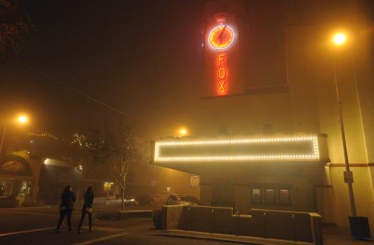 The Visalia Fox Theatre glows in the fog in downtown Visalia.