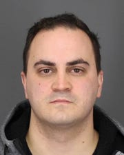 Michael Agovino, a Peekskill police officer, was arrested on Feb. 15, 2020 and charged with sexually abusing a woman.