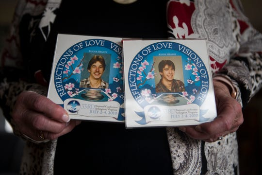 Othell Heaney holds photographs of her late sons Roger and Kevin Heaney who passed away in the 1980s.