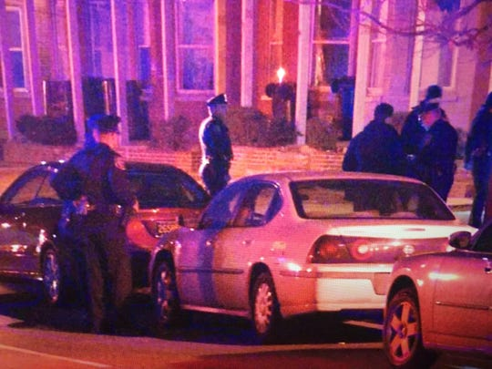 Police investigate a shooting in the 800 block of N. Adams St. in Wilmington on Sunday night that killed two men.