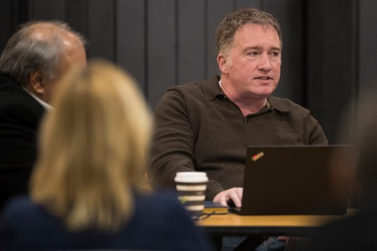 Odyssey Charter School board member John Nicholson speaks during a special meeting of the school board Sunday night at the lower school.