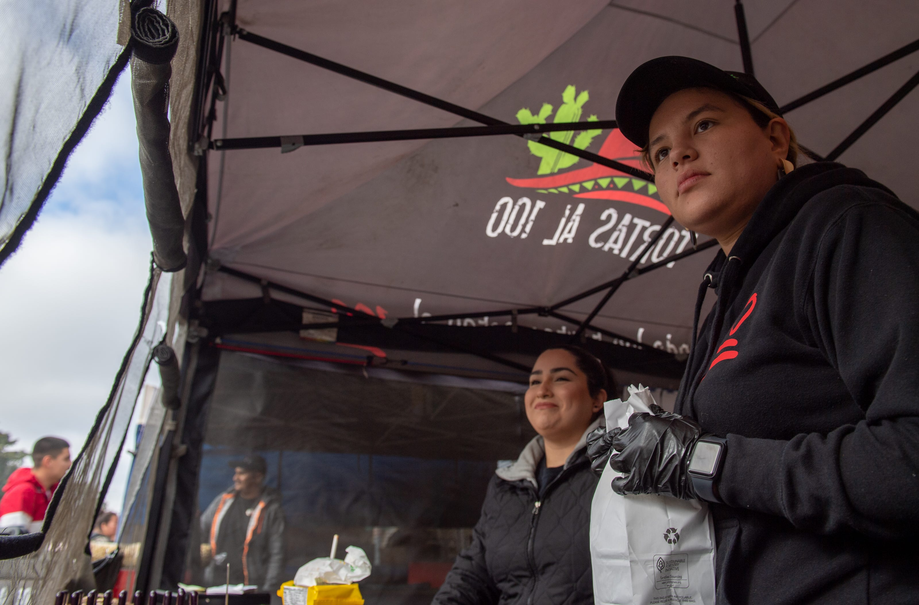 Diane Haro, left, and Herminia Cervantes both wait for a customer to pick up their order at Tortas Al 100 on Feb. 08, 2020.
