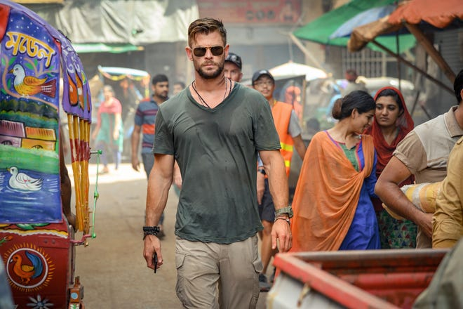 "Chris Hemsworth stars as a black-market mercenary who's on a rescue mission and a path of redemption in the Netflix action movie ""Extraction."""