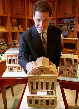 David Armstrong-Jones, then Viscount Linley, shows some of the humidor boxes he makes for Alford Dunhill at their Chicago Store, in May 1994.
