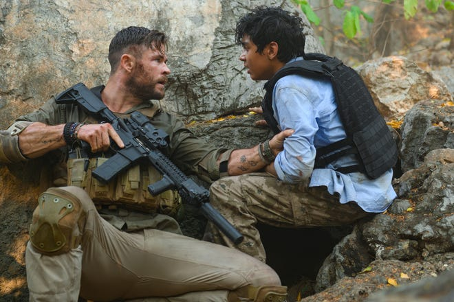 "Tyler Rake (Chris Hemsworth) is hired to rescue a crime lord's kidnapped son (Rudhraksh Jaiswalz) in ""Extraction."""