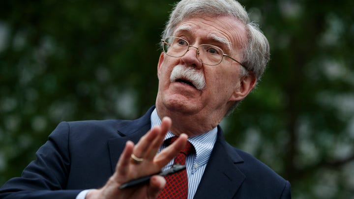 FILE - In this May 1, 2019 file photo, National security adviser John Bolton talks to reporters outside the White House in Washington. (AP Photo/Evan Vucci) ORG XMIT: WX103