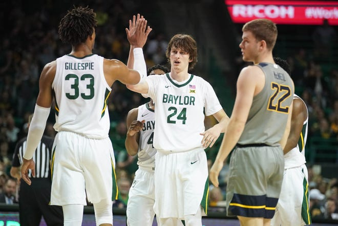 Baylor guard Matthew Mayer (24) and forward Freddie Gillespie celebrate during the team's win against West Virginia at Ferrell Center.