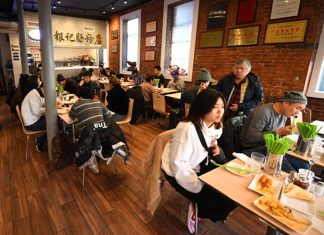 Yin Ji Chang Fen, a restaurant in Manhattan's Chinatown, has seen business drop 30% to 40% since the coronavirus outbreak in China. Manager Steve Ip has had to cut back on employees' shifts and started to do delivery, which he couldn't do previously because the restaurant was too busy.