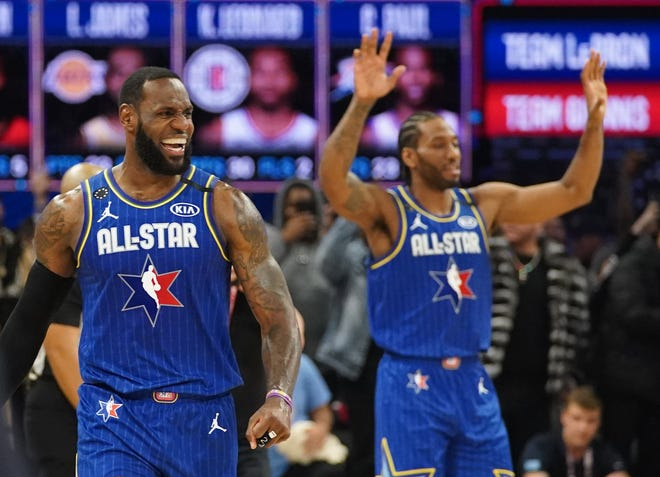 Team LeBron forwards LeBron James and Kawhi Leonard celebrate after defeating Team Giannis in the NBA All Star Game.
