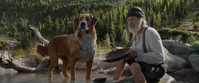 "Harrison Ford as John Thornton with his trusted dog Buck in ""The Call of the Wild."""