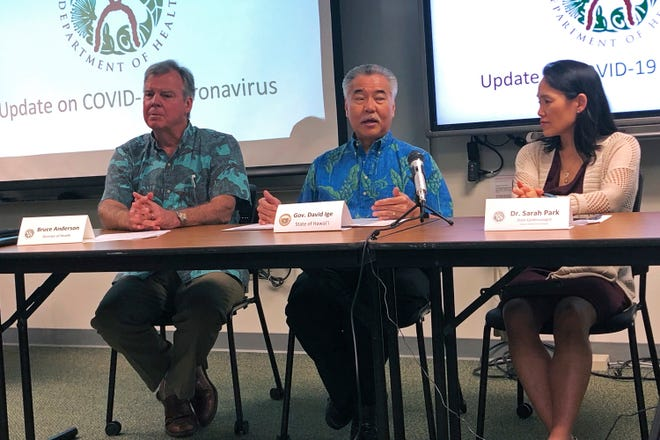 Hawaii Gov. David Ige, center, state Health Director Bruce Anderson, left, and state epidemiologist Sarah Park, said they are focusing their efforts on Oahu since that is where the man began to exhibit symptoms.
