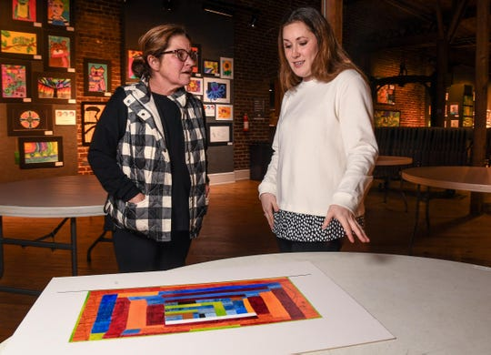 Jacqueline Ashley, left, of Foster's Main Events, and Addy Smith, Leadership Anderson Class 36 project manager, talk about the Mural on Main project at the Anderson Arts Center in downtown Anderson Tuesday.