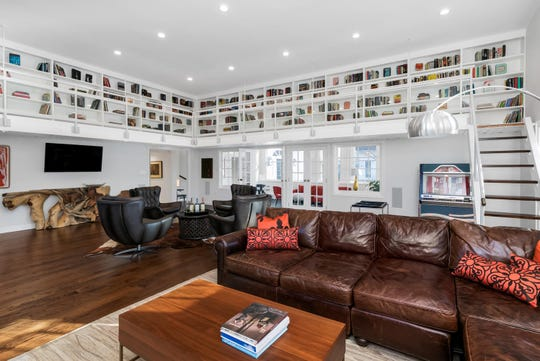 The great room features a custom-crafted wet bar and a built-in bookcase.