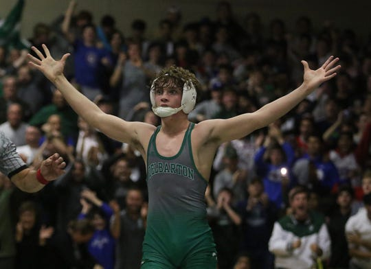Delbarton's Joe Davi celebrates after he defeated Bergen Catholic's Nick Kayal in the 120-pound bout in the Green Wave's 45-12 win in a NJSIAA Non-Public North A semifinal. The win enabled Delbarton to dislodge Bergen Catholic from the No. 1 spot in the final  NJWWA Top 20