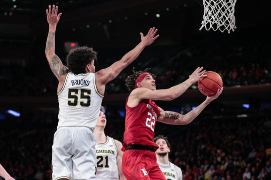 Rutgers Scarlet Knights guard Caleb McConnell (22) shoots the ball as Michigan Wolverines guard Eli Brooks (55) defends during the second half at Madison Square Garden.
