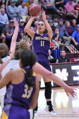 Merkel's Kaydi Pursley (11) takes a shot during a Region I-3A bi-district playoff game against Bangs. Pursley followed with a 39-point performance in the area round.