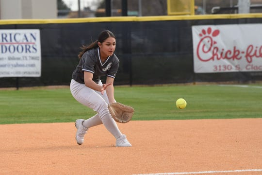 Abilene High second baseman Jailyn Shaw (2) looks in a ground ball during the 2020 season opener against Wichita Falls Rider. Shaw is one of several young players helping the Lady Eagles this year on varsity.