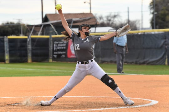 Abilene High pitcher Aubrianna Salazar (12) goes through her windup during the season opener against Wichita Falls Rider on Monday. Salazar pitched a complete-game shutout, allowing two hits and striking out nine as the Lady Eagles won 11-0 in five innings.