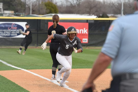 Abilene High's Lanay Carr (5) tags up and scores from third on a fly ball to left field during the season opener against Wichita Falls Rider. Carr hit a grand slam in the final game of the Liberty Hill tournament for her first career home run as the young Lady Eagles are starting to get more comfortable at the varsity level.