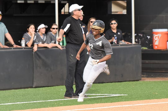 Abilene High's KK Roberson (22) rounds third and scores during the season opener against Wichita Falls Rider on Monday. Roberson had two hits and scored a run in the 11-0, five-inning victory.