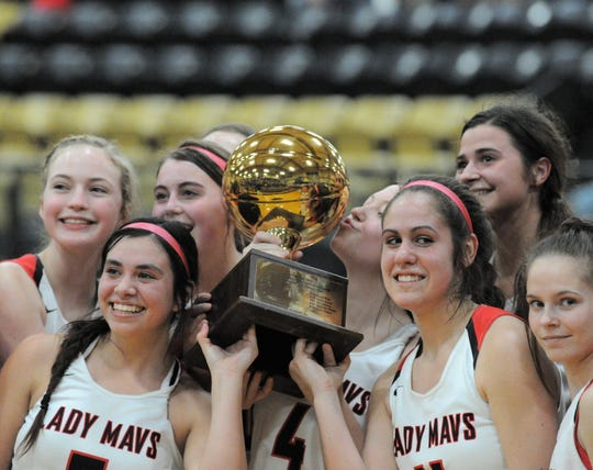 The Eastland girls basketball team poses with its trophy after beating Colorado City in a Region I-3A bi-district playoff Tuesday, Feb. 17, 2020, at Clyde High School.