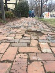 Restoration of brick sidewalks helped usher in the current renaissance of Biltmore Village.