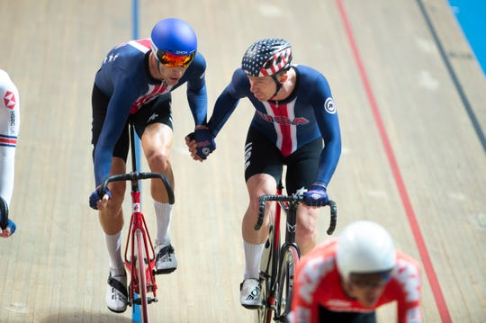 Adrian Hegyvary, left, of Asheville, passes off to his teammate Daniel Holloway, at the 2019 UCI Track World Championships in the Madison race. Hegyvary has been chosen to represent the United States at the 2020 World Championships in Berlin, Germany.
