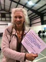 Libba Tracy holds up her vision for Black Mountain during a public input session for the town's 30-year comprehensive plan.