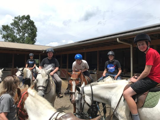 Hickory Nut Gap Farm has day camps for kids in Fairview, with horseback riding, crafts and more.