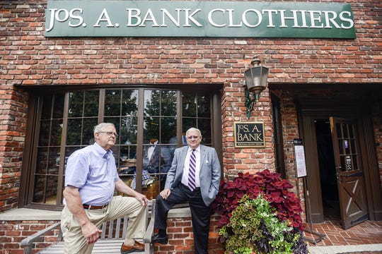 Bill Bell, left, and Jodie Anderson stand outside the Jos. A Bank store in Biltmore Village, Thursday, Sept. 4, 2014.