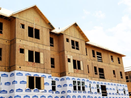 The city of Asheville follows state building codes, which do allow for the construction of wood-framed hotels and apartments, such as these that went up on Gerber Road a few years ago.