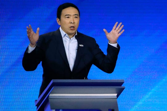 In this Feb. 7 photo, former Democratic presidential candidate Andrew Yang speaks during a Democratic presidential primary debate at Saint Anselm College in Manchester, N.H.