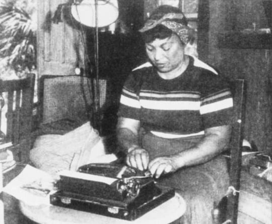 Zora Neale Hurston at her typewriter in her Eau Gallie, Melbourne, Florida, cottage. This is one of the only photos of Hurston in Brevard County.