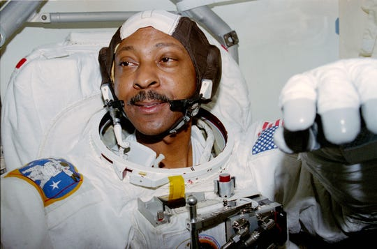 STS087-317-036 (19 November – 5 December 1997) --- Astronaut Winston E. Scott, mission specialist, goes through final touches of spacesuit donning in preparation for one of two extravehicular activities (EVA) he performed in and around the cargo bay of the Space Shuttle Columbia.  Scott was joined by astronaut Takao Doi, an international mission specialist representing Japan's National Space Development Agency (NASDA), on both EVAs.