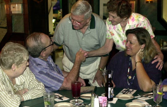 When the late Milt Salamon (second from left), a longtime FLORIDA TODAY columnist, retired in 2001, he went to Bernard's Surf in Cocoa Beach to say goodbye to colleagues and readers.