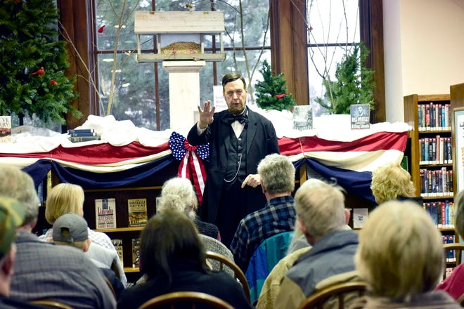 Jerry Payn poses as President Abraham Lincoln while speaking to patrons at the Galion Public Library on Monday.