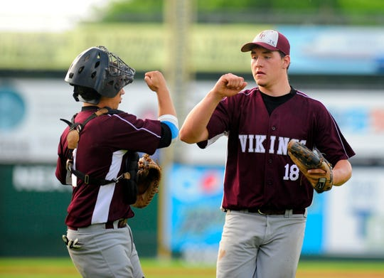 Lyndon's Buddy Lamothe, right,  shown during the 2009 Division II high school baseball state championship game at Centennial Field.