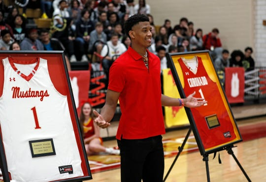 Jarrett Culver poses with his retired jerseys during the ceremony Tuesday, Feb. 18, 2020, at Coronado High in Lubbock, Texas. [Brad Tollefson/A-J Media]