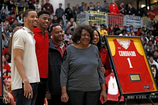 Jarrett Culver poses with his family by his retired jerseys during the ceremony Tuesday, Feb. 18, 2020, at Coronado High in Lubbock, Texas. [Brad Tollefson/A-J Media]