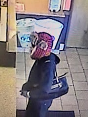 Police are looking for this woman in connection with a robbery at a Cherry Hill Dunkin'.