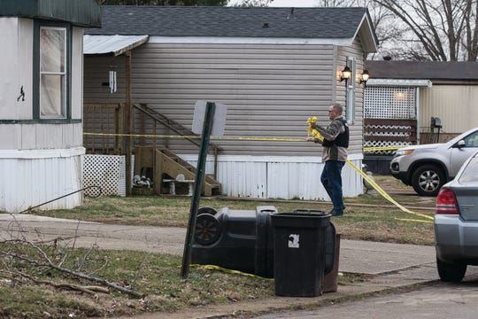 Sgt. Pete Shaw removes the police do not cross tape around a residence where an altercation occurred on Cheyenne Drive that sent three Chillicothe police officers to the hospital Tuesday afternoon.