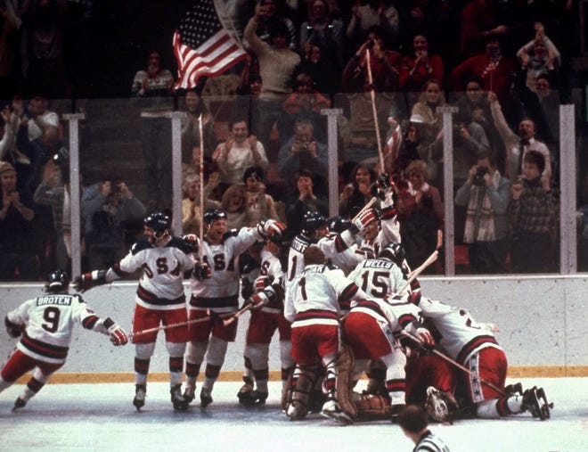 """The U.S. hockey team pounces on goalie Jim Craig after a 4-3 victory against the Soviet Union, known as """"the Miracle on Ice,""""  in the 1980 Olympics in Lake Placid, New York."""