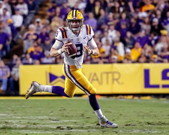 Nov 30, 2019; Baton Rouge, LA: LSU Tigers quarterback Joe Burrow (9) scrambles against the Texas A&M Aggies during the second half at Tiger Stadium.