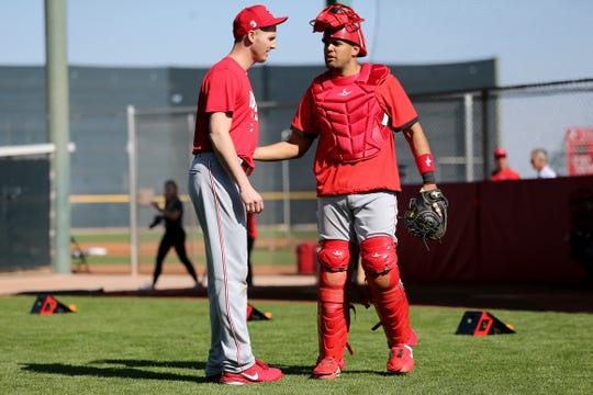 Cincinnati Reds non-roster invitee pitcher Nate Jones (57) talks with non-roster invitee catcher Francisco Pena (75) during a bullpen session, Monday, Feb. 17, 2020, at the baseball team's spring training facility in Goodyear, Ariz.