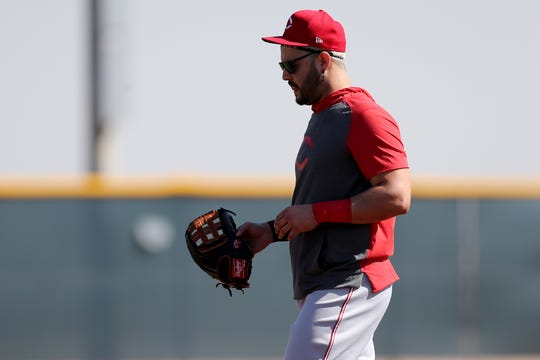 Cincinnati Reds third baseman Eugenio Suarez (7) paces in the area of third base during fielding drills, Tuesday, Feb. 18, 2020, at the baseball team's spring training facility in Goodyear, Ariz.