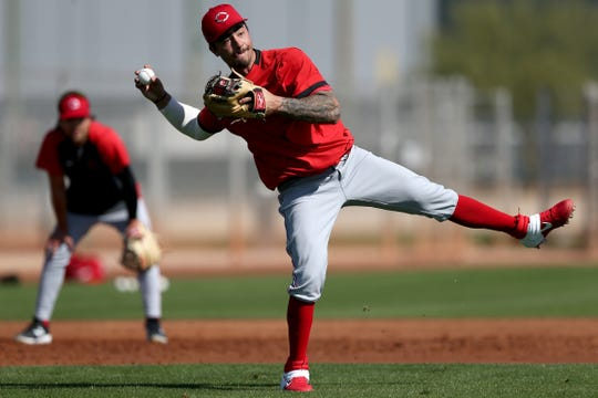 Cincinnati Reds non-roster invitee infielder Jonathan India (85) throws to first base during fielding drills, Tuesday, Feb. 18, 2020, at the baseball team's spring training facility in Goodyear, Ariz.
