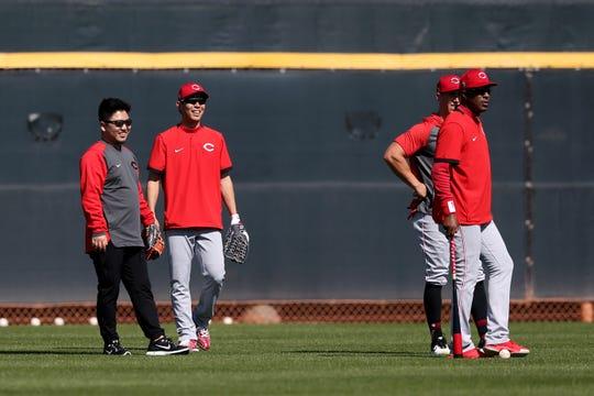 Cincinnati Reds center fielder Shogo Akiyama (4), center, smiles in the outfield during drills, Tuesday, Feb. 18, 2020, at the baseball team's spring training facility in Goodyear, Ariz.