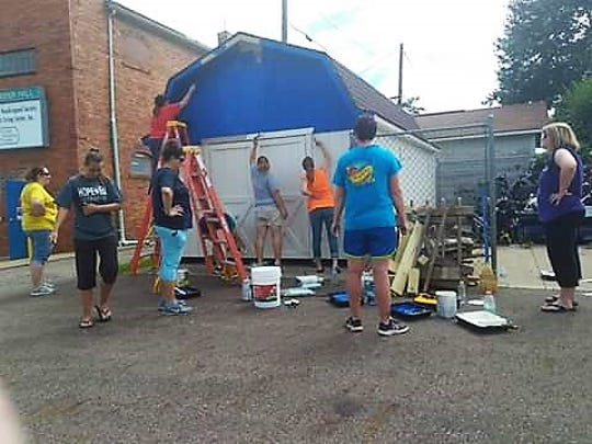Volunteers from Hopewell School and AK Steel last year helped to repaint a shed and parking lot lines at the Coshocton County Handicapped Society's headquarters.